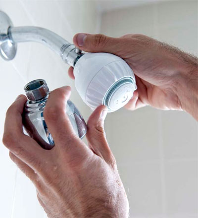 Hands Adjusting Showerhead