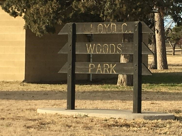 A wood sign that reads LLoyd C Woods Park