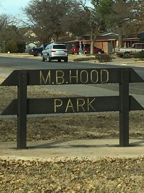 A wood sign that reads M.B. Hood Park