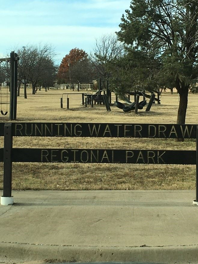 A wood sign that reads Running Water Draw Regional Park